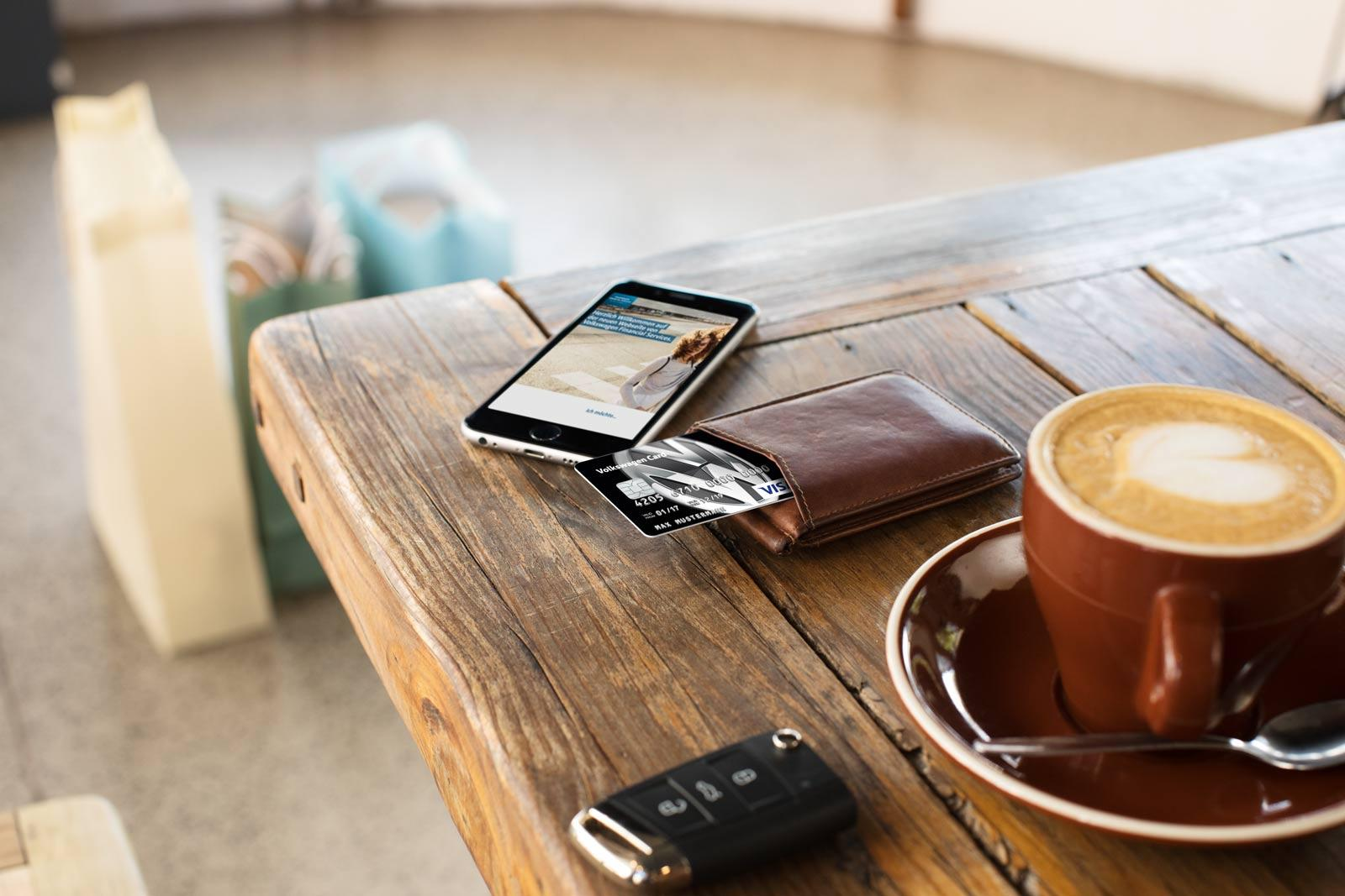 phone-and-wallet-with-black-credit-card-on-the-table